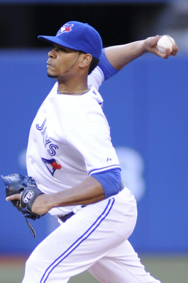 Toronto Blue Jays' Esmil Rogers pitches against the Los Angeles Dodgers during the first inning of a baseball game on Wednesday July 24, 2013, in Toronto. (AP Photo/The Canadian Press, Jon Blacker)
