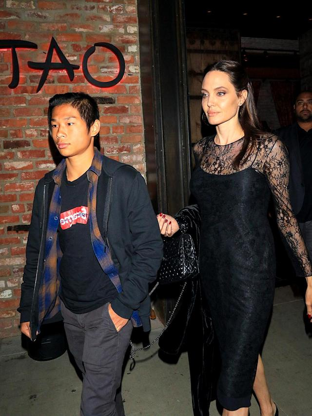"<p>The movie star and her 13-year-old son, Pax Jolie-Pitt, had a mother-son date on <a href=""https://www.yahoo.com/celebrity/stars-celebrate-mother-day-2017-slideshow-wp-205056659.html"" data-ylk=""slk:Mother's Day;outcm:mb_qualified_link;_E:mb_qualified_link"" class=""link rapid-noclick-resp newsroom-embed-article"">Mother's Day</a> at Tao restaurant in L.A. The mom of six also spent part of her day <a href=""http://www.dailymail.co.uk/tvshowbiz/article-4508534/Angelina-Jolie-enjoys-low-key-Mother-s-Day.html"" rel=""nofollow noopener"" target=""_blank"" data-ylk=""slk:taking a walk with three of her younger children"" class=""link rapid-noclick-resp"">taking a walk with three of her younger children</a>: 10-year-old Shiloh and twins Vivienne and Knox, 8. (Photo: gotpap/Bauer-Griffin/GC Images) </p>"