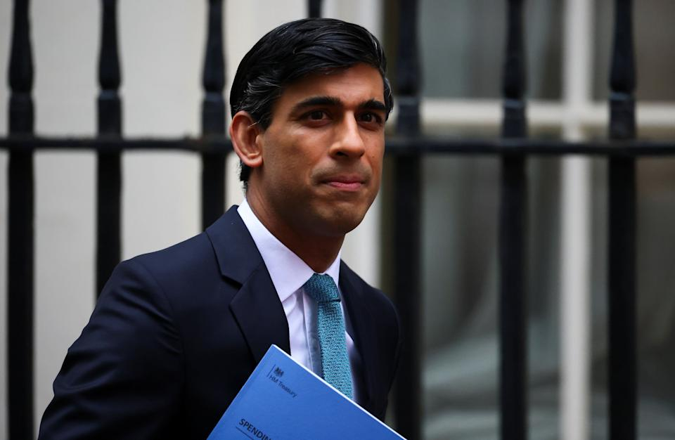 Chancellor Rishi Sunak leaves Downing Street to deliver his spending review to the Commons (Photo: Henry Nicholls / Reuters)