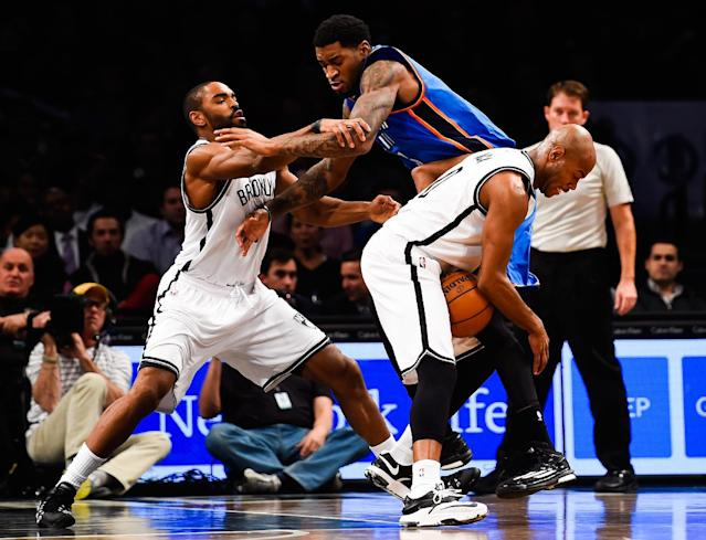 Jarrett Jack and Alan Anderson of the Brooklyn Nets fight for the ball with Perry Jones of Oklahoma City Thunder in the second half at the Barclays Center on November 3, 2014 in the Brooklyn borough of New York City (AFP Photo/Alex Goodlett)