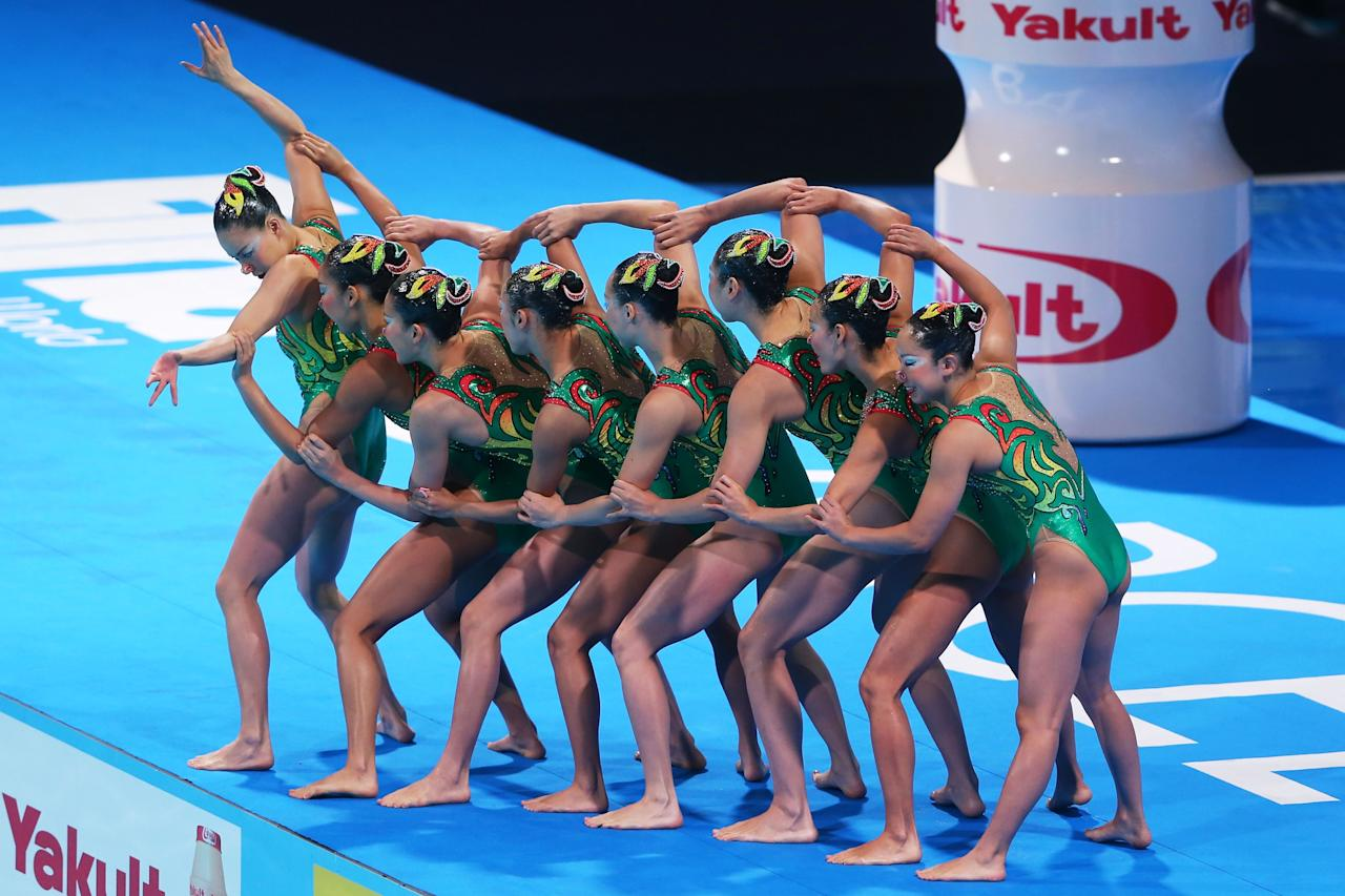 BARCELONA, SPAIN - JULY 23: Japan compete in the Synchronized Swimming Team preliminary round on day four of the 15th FINA World Championships at Palau Sant Jordi on July 23, 2013 in Barcelona, Spain. (Photo by Alexander Hassenstein/Getty Images)