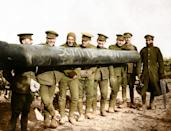 <p>A group of men from the Royal Regiment of Artillery, photographed alongside a long-barrelled field gun, 1916. For the occasion, they have chalked the words, 'Somme gun' on the side of the barrel. The men are well wrapped with non-uniform scarves, gloves and a balaclava. In purely military terms, the heavy artillery of both sides was in many ways more important than any other weapon. It could fire into the opposing trenches with little risk to their own side and could effectively keep the enemy in the trenches. (Tom Marshall/mediadrumworld.com) </p>