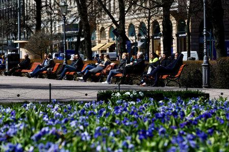 FILE PHOTO: People enjoy a sunnny day at the Esplanade in Helsinki, Finland, May 3, 2017.  REUTERS/Ints Kalnins/File Photo