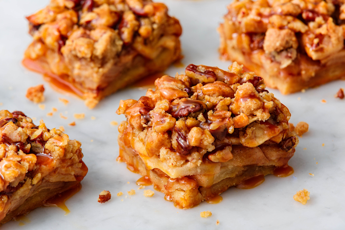 """<p>Apple pie in snackable form.<br></p><p>Get the recipe from <a href=""""https://www.delish.com/holiday-recipes/thanksgiving/a23104970/apple-pie-bars-recipe/"""" rel=""""nofollow noopener"""" target=""""_blank"""" data-ylk=""""slk:Delish"""" class=""""link rapid-noclick-resp"""">Delish</a>.</p>"""