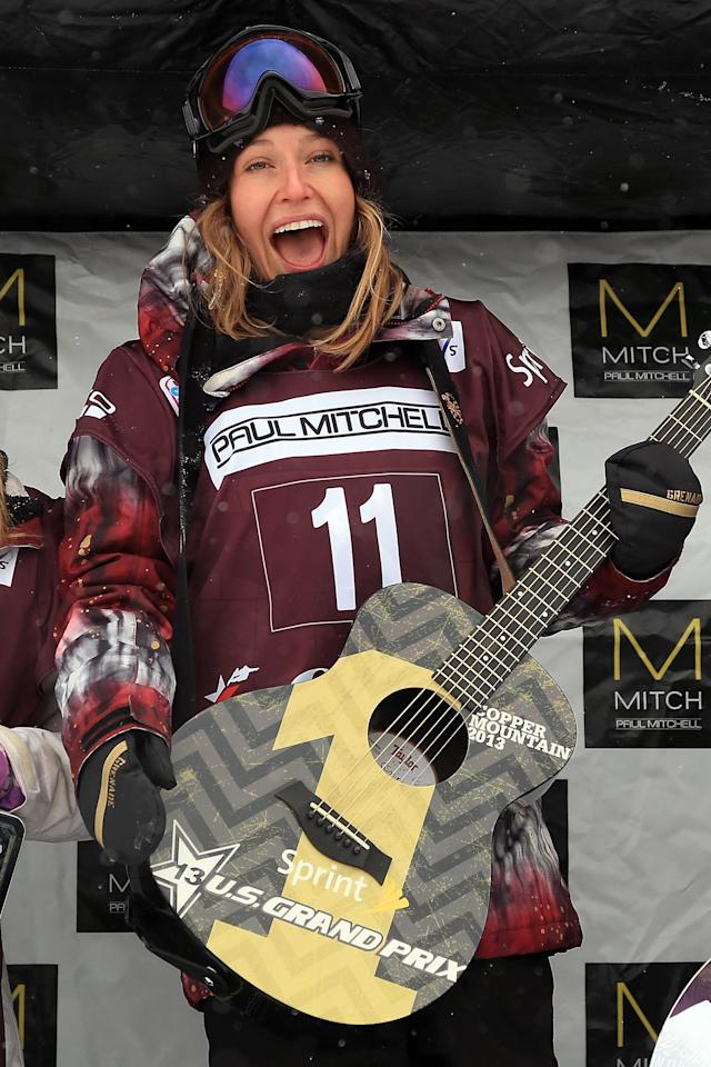 COPPER MOUNTAIN, CO - JANUARY 11: Jamie Anderson of the USA celebrates on the podium after winning the FIS Snowboard Slope Style World Cup at the US Grand Prix on January 11, 2013 in Copper Mountain, Colorado. (Photo by Doug Pensinger/Getty Images)