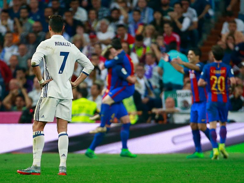 Cristiano Ronaldo looks on after Lionel Messi's late winner at the Bernabeu: Getty