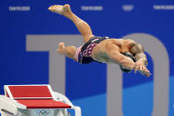 Caeleb Dressel, of the United States, dives off the starting block in the men's 50-meter freestyle final at the 2020 Summer Olympics, Sunday, Aug. 1, 2021, in Tokyo, Japan. (AP Photo/David Goldman)