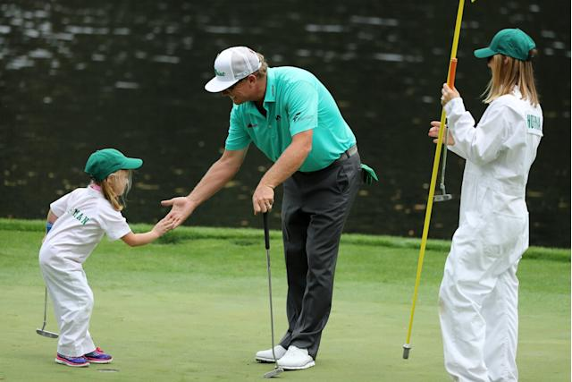 Charley Hoffman of the U.S. slaps hands with his daughter during the par 3 contest held on the final day of practice for the 2018 Masters golf tournament at Augusta National Golf Club in Augusta, Georgia, U.S. April 4, 2018. REUTERS/Lucy Nicholson