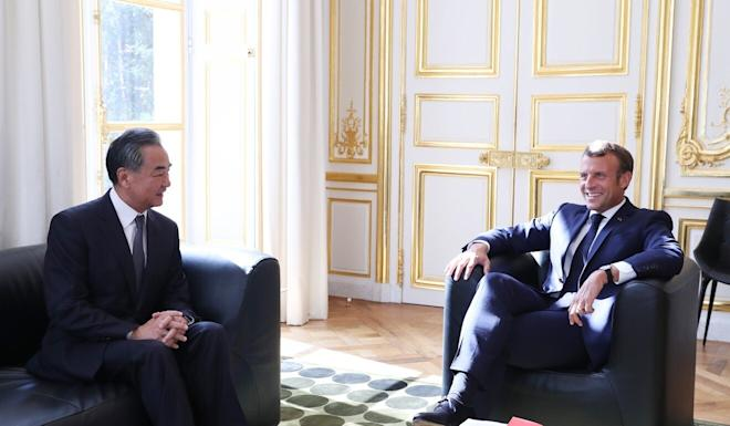 French President Emmanuel Macron (right) meets Chinese Foreign Minister Wang Yi at the Elysee Palace in Paris, France, on Friday. Photo: Xinhua