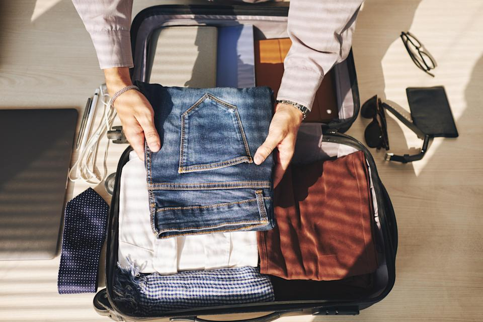 Experts recommend laying everything out before packing your bag.