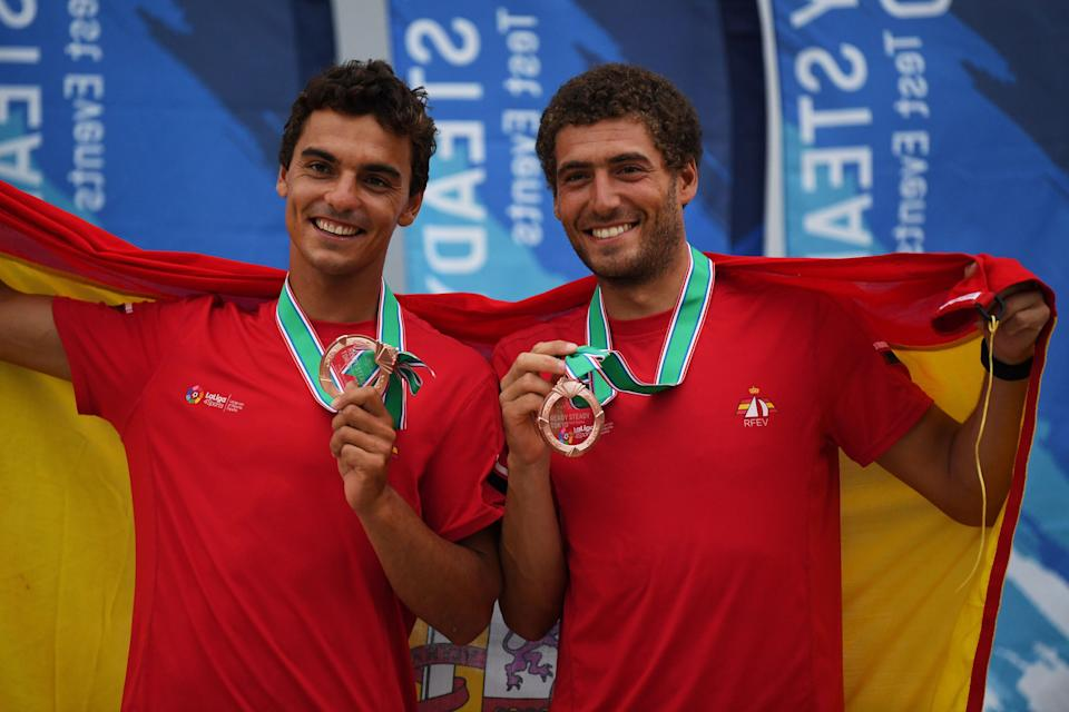 Spain's Jordi Xammar and Nicolas Rodriguez celebrate third place during the awards ceremony for the men's two person Dinghy 470 class medal competition at a sailing test event for the Tokyo 2020 Olympic Games, at Enoshima Yacht Harbour in Kanagawa Prefecture on August 22, 2019. (Photo by CHARLY TRIBALLEAU / AFP)        (Photo credit should read CHARLY TRIBALLEAU/AFP via Getty Images)