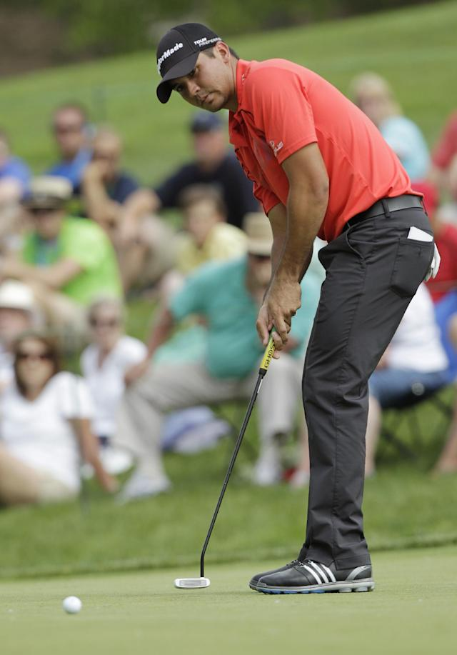 Jason Day, of Australia, putts on the ninth hole during the first round of the Memorial golf tournament Thursday, May 29, 2014, in Dublin, Ohio. (AP Photo/Jay LaPrete)