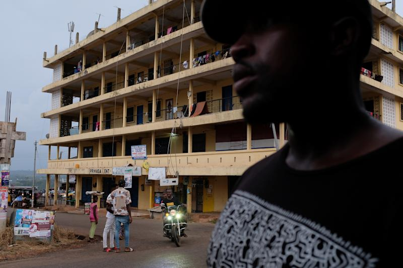 A man walks past a torn-down colonial building in Mampong, Ashanti region, Ghana. (Photo: Francis Kokoroko/Reuters)