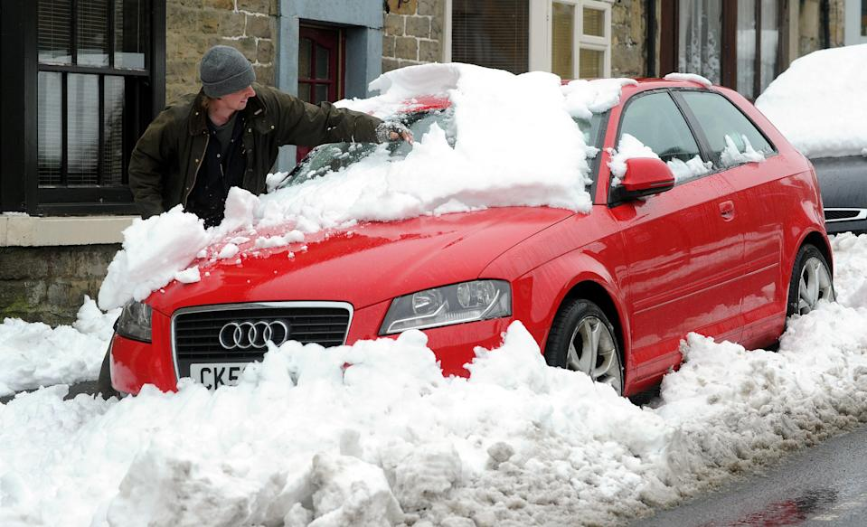 Drivers must clear all snow and ice from their windscreens and windows before setting off (Owen Humphreys/PA Images via Getty Images)