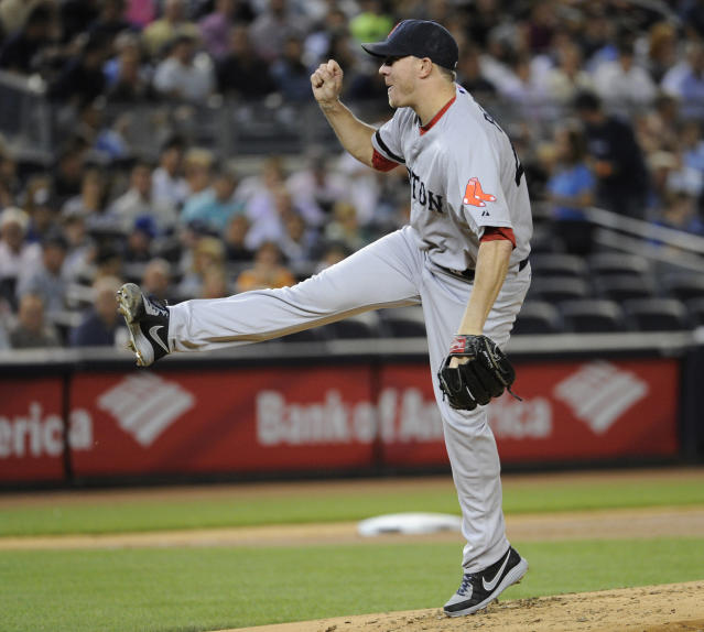 Boston Red Sox pitcher Jake Peavy delivers to the New York Yankees during the second inning of a baseball game on Thursday, Sept. 5, 2013, at Yankee Stadium in New York. (AP Photo/Bill Kostroun)
