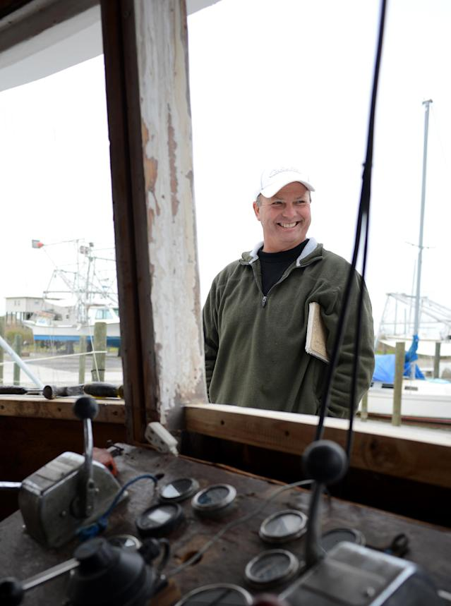 CORRECTS SPELLING - Bert Ducote poses for a picture on his boat at the Lake Catherine Marina in New Orleans, Friday, March 7, 2014. Ducote has had dozens of boils appear on his skin, which he claims are the result of being in direct contact with crude oil while performing cleanup work during the Deepwater Horizon oil spill. (AP Photo/Andrea Mabry)