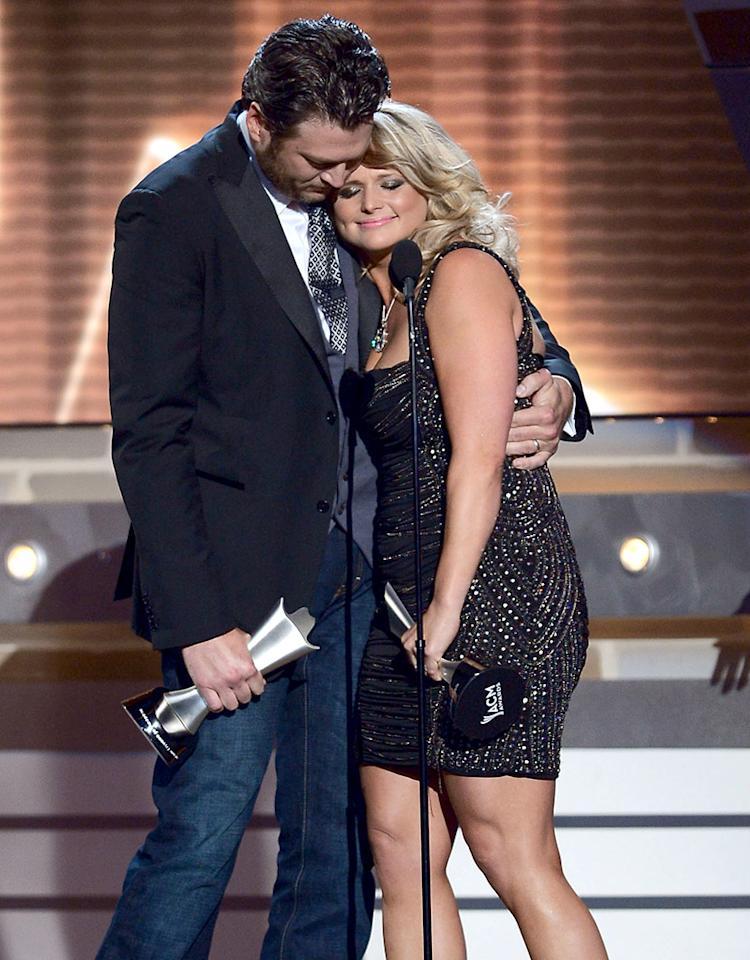 "LAS VEGAS, NV - APRIL 07:  Musicians Blake Shelton (L) and Miranda Lambert accept the award for Song of the Year for ""Over You"" onstage during the 48th Annual Academy of Country Music Awards at the MGM Grand Garden Arena on April 7, 2013 in Las Vegas, Nevada.  (Photo by Ethan Miller/Getty Images)"