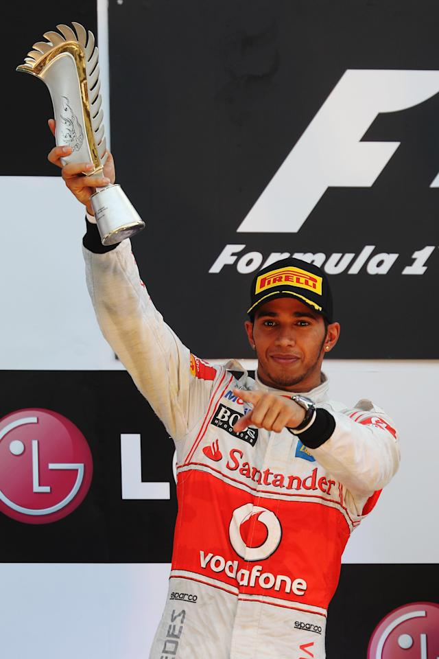 YEONGAM-GUN, SOUTH KOREA - OCTOBER 16: Lewis Hamilton of Great Britain and McLaren celebrates in parc ferme after finishing second during the Korean Formula One Grand Prix at the Korea International Circuit on October 16, 2011 in Yeongam-gun, South Korea. (Photo by Mark Thompson/Getty Images)