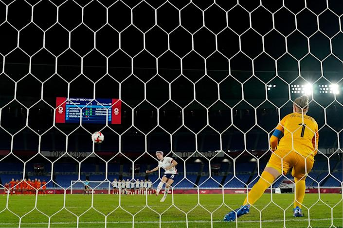 Team United States forward Megan Rapinoe (15) scores in a penalty shoot out against the Netherlands to win their women's quarterfinals match during the Tokyo 2020 Olympic Summer Games at International Stadium Yokohama.