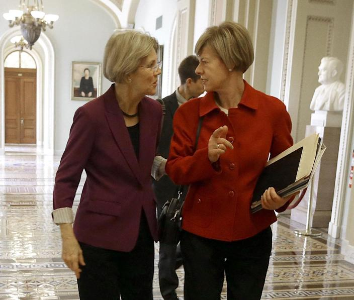 FILE - This Nov. 13, 2012 file photo shows Sen-elect Elizabeth Warren, D-Mass., left, and Sen-elect, current Rep. Tammy Baldwin, D-Wis. walking together on Capitol Hill in Washington. When the next Congress cranks up in January, there will be more women, many new faces and 11 fewer of the tea party-backed 2010 House GOP freshmen who sought re-election. Overriding those changes, though, is a thinning of pragmatic, centrist veterans in both parties. Among those leaving are some of the Senate's most pragmatic lawmakers in both parties, nearly half the House's centrist Blue Dog Democrats and several moderate House Republicans. (AP Photo/Pablo Martinez Monsivais, File)