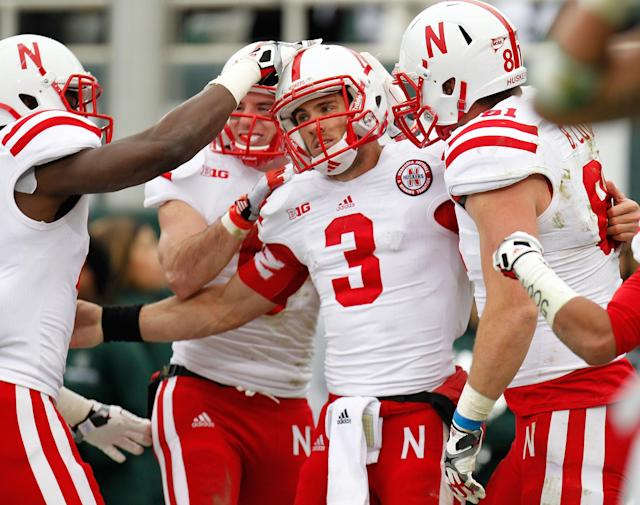EAST LANSING, MI - NOVEMBER 03: Taylor Martinez #3 of the Nebraska Cornhuskers celebrates a second quarter touchdown with teammates while playing the Michigan State Spartans at Spartan Stadium Stadium on November 3, 2012 in East Lansing, Michigan. (Photo by Gregory Shamus/Getty Images)