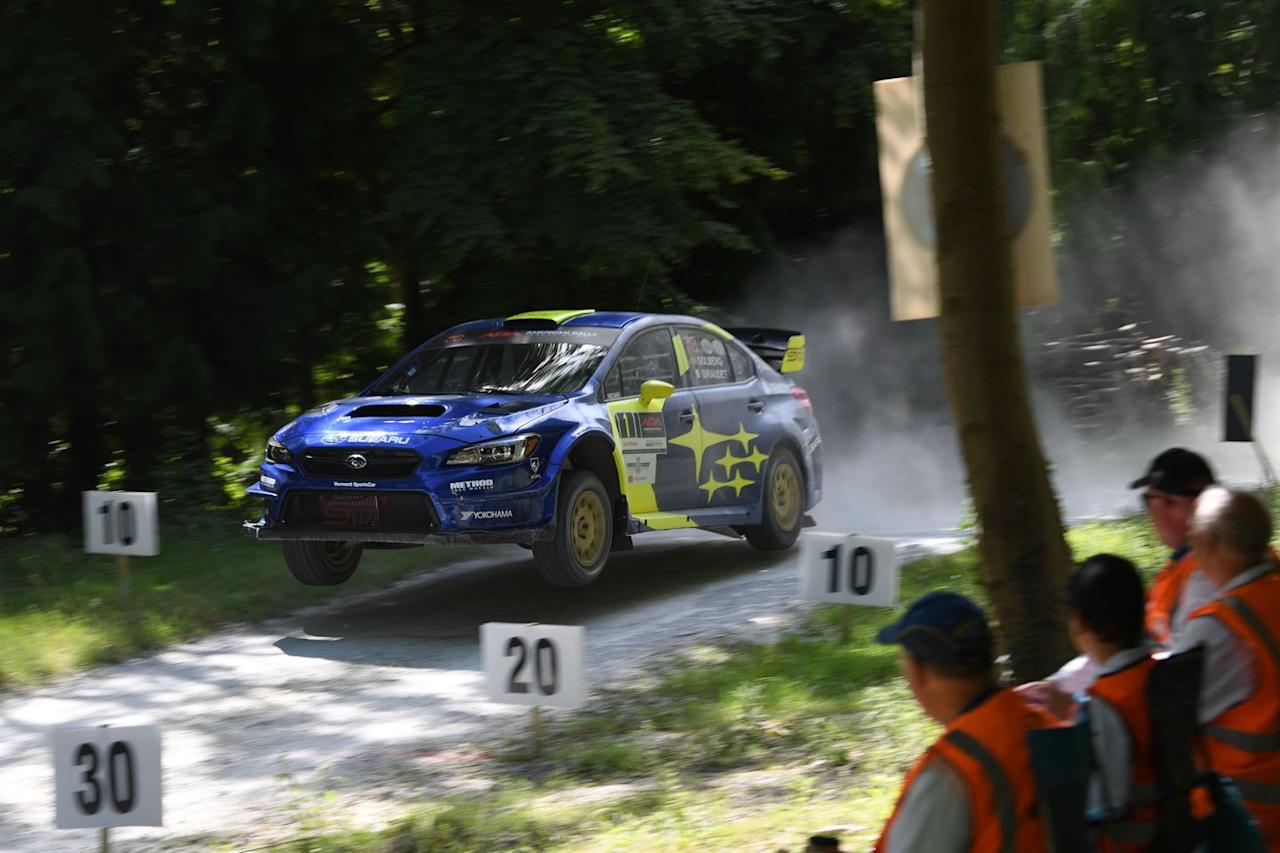 "<p>The rally stage at Goodwood isn't nearly as well known as the hill-climb, but it's just as much fun to watch—if not more so. We spent hours gazing at rally-prepped cars new and old, from old Saabs to World Rally Championship cars to even <a href=""https://www.caranddriver.com/news/a25016780/jaguar-f-type-convertible-rally-car/"" target=""_blank"">a Jaguar F-type rally car</a>, running through the woods. We were even lucky enough to snag a ride in Subaru's STI rally car running in the American Rally open class, piloted by none other than Oliver Solberg, the 17-year-old son of world champion Petter Solberg.</p>"