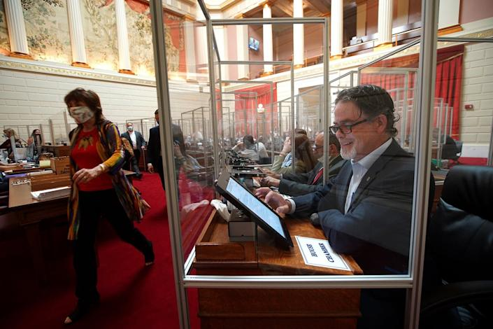 """<span class=""""caption"""">When the Rhode Island General Assembly returned on June 17, 2020, plexiglass separated the desks as a coronavirus precaution. Republican Rep. Michael Chippendale was among members without a mask on.</span> <span class=""""attribution""""><a class=""""link rapid-noclick-resp"""" href=""""https://www.gettyimages.com/detail/news-photo/providence-ri-6-17-2020-pictured-is-the-ri-house-chambers-a-news-photo/1221043872"""" rel=""""nofollow noopener"""" target=""""_blank"""" data-ylk=""""slk:Barry Chin/The Boston Globe via Getty Images"""">Barry Chin/The Boston Globe via Getty Images</a></span>"""