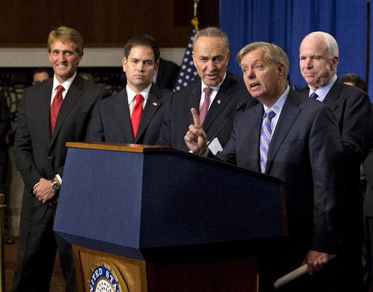 FILE - In this April 18, 2013 file photo, Sen. Lindsey Graham, R-S.C., second from right, speaks about immigration reform during a news conference on Capitol Hill in Washington. Senators weighing a landmark immigration bill defeated an effort by Republicans Tuesday to require biometric identification _ such as fingerprinting _ to track who is entering and leaving the country. The amendment by Sen. Jeff Sessions, R-Ala., would have required a biometric system to be in place before any immigrant here illegally could obtain permanent residency or citizenship. From left are, Sen. Jeff Flake, R-Ariz., Sen. Marco Rubio, R-Fla., Sen. Charles Schumer, Graham, and Sen. John McCain, R-Ariz. (AP Photo/J. Scott Applewhite, File)