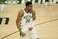 Milwaukee Bucks' Giannis Antetokounmpo reacts after teammate Khris Middleton made a three-point basket during the second half of Game 4 of the NBA Eastern Conference basketball semifinals game against the Brooklyn Nets Sunday, June 13, 2021, in Milwaukee. (AP Photo/Morry Gash)