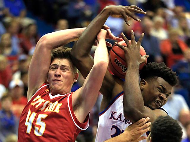 <p>Pittsburg State forward Jonathan Murray (45) rebounds against Kansas center Udoka Azubuike, right, during the first half of an exhibition NCAA college basketball game in Lawrence, Kan., Tuesday, Oct. 31, 2017. (AP Photo/Orlin Wagner) </p>