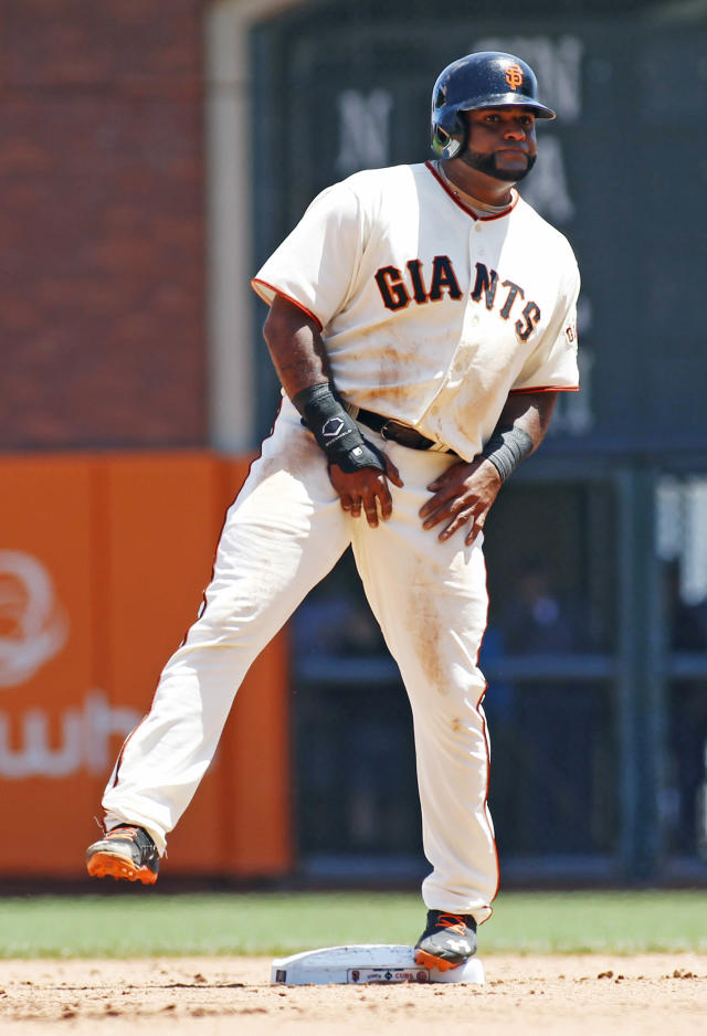 San Francisco Giants' Pablo Sandoval lifts his leg upon advancing tho second base on a wild pitch during the fourth inning of a baseball game against the Chicago Cubs, Wednesday, May 28, 2014, in San Francisco. (AP Photo/George Nikitin)
