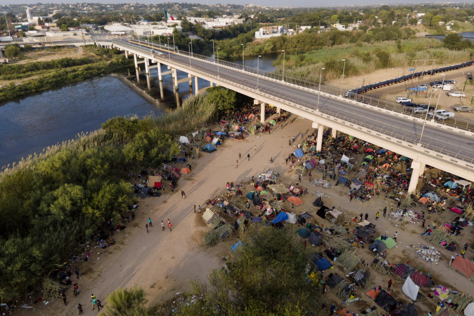 FILE - In this Tuesday, Sept. 21, 2021, file photo, migrants, many from Haiti, are seen at an encampment along the Del Rio International Bridge near the Rio Grande in Del Rio, Texas. The U.S. is flying Haitians camped in a Texas border town back to their homeland and blocking others from crossing the border from Mexico. On Friday, the camp on the U.S. side that once held as many as 15,000 mostly Haitian refugees was completely cleared. (AP Photo/Julio Cortez, File)