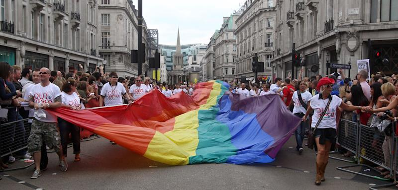 Revellers take part in the annual Gay Pride parade, in central London.