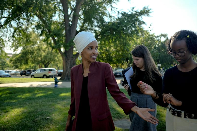 Omar on Capitol Hill with a staffer (center) and her daughter, Isra Hirsi (right), on July 15, 2019. | Gabriella Demczuk for TIME