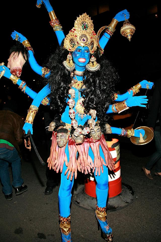 <p>In 2008, the so-called Queen of Halloween courted controversy by dressing as Kali, the Hindu goddess of destruction. Her portrait of the deity with the vampire fangs and a skirt made of severed bloody hands upset Hindu leaders. (Photo: Charles Eshelman/Getty Images) </p>
