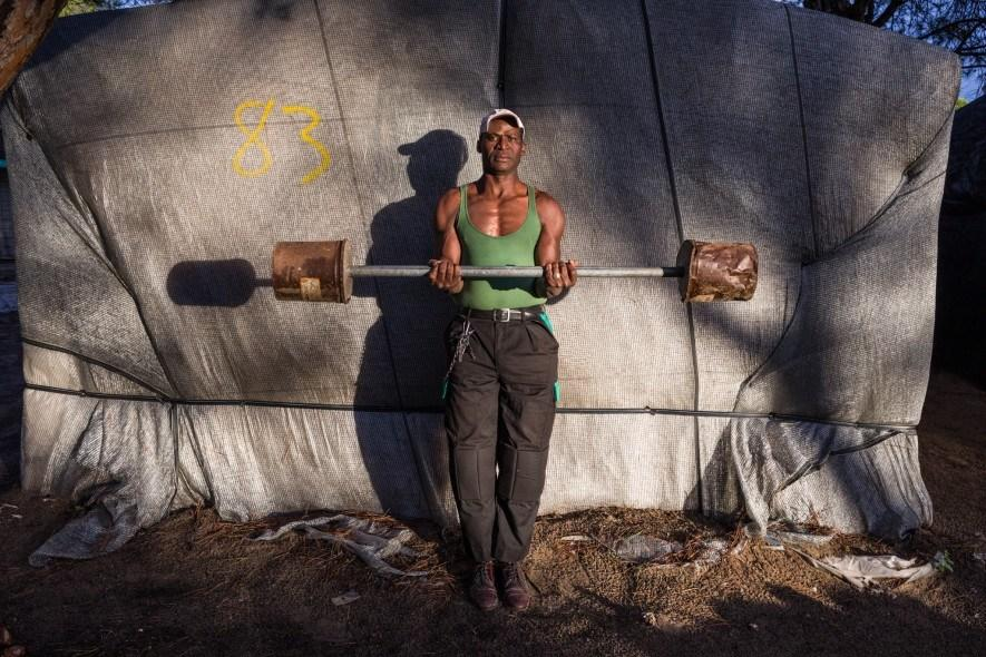 ssa Diakite, 50, built both his barbell and his home, one of dozens of chabolas clustered near an Andalusian agricultural region. Originally from Mali, he settled in as a regular field-worker and now helps others construct solid shacks. (Picture: National Geographic/Yagazie Emezi)