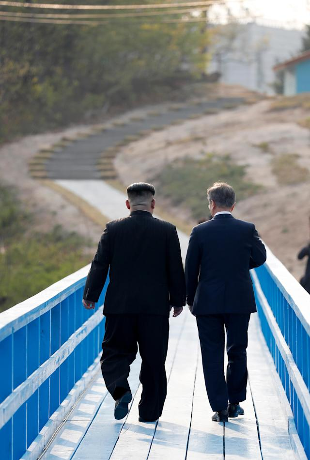 <p>North Korean leader Kim Jong-Un (L) talks with South Korean President Moon Jae-In (R) at the Joint Security Area (JSA) on the Demilitarized Zone (DMZ) in the border village of Panmunjom in Paju, South Korea, April 27, 2018. (Photo: Korea Summit Press Pool/EPA-EFE/REX/Shutterstock) </p>
