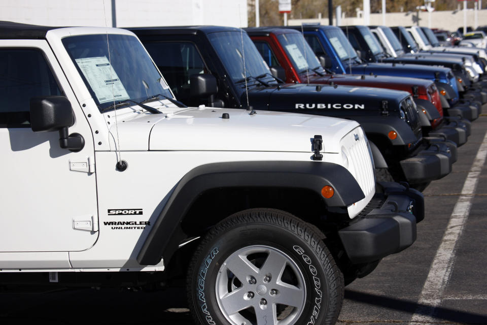 FILE- In this Nov. 1, 2009, file photo unsold 2010 Wranglers sit at a Chrysler/Jeep dealership in Englewood, Colo. Fiat Chrysler is recalling more than 1.6 million vehicles worldwide to replace Takata front passenger air bag inflators that can be dangerous. The recall covers the 2010 through 2016 Jeep Wrangler SUV, the 2010 Ram 3500 pickup and 4500/5500 Chassis Cab trucks, the 2010 and 2011 Dodge Dakota pickup, the 2010 through 2014 Dodge Challenger muscle car, the 2011 through 2015 Dodge Charger sedan, and the 2010 through 2015 Chrysler 300 sedan. (AP Photo/David Zalubowski, File)
