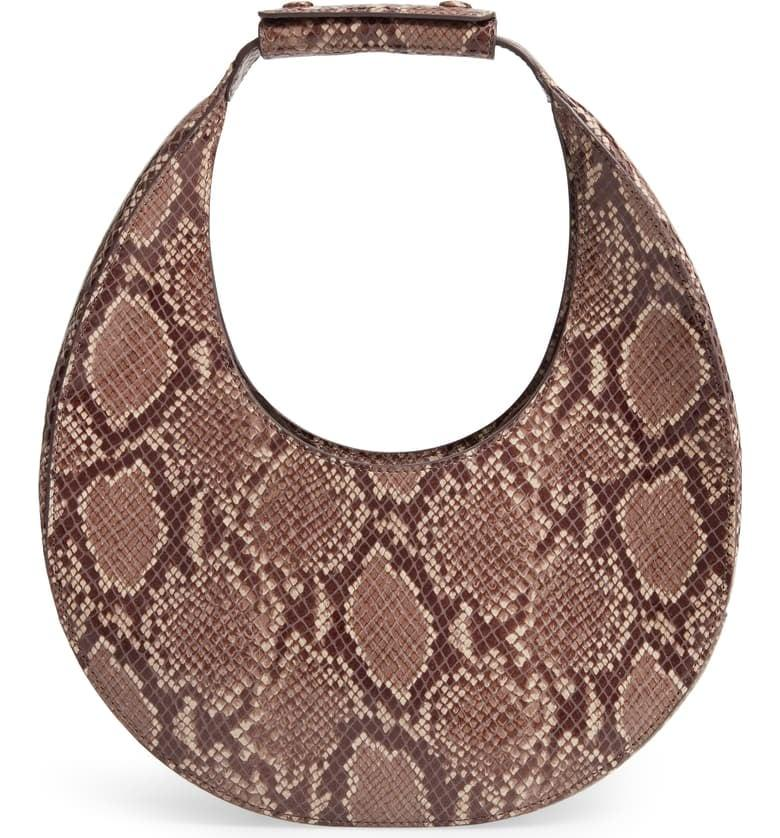 "<p>Everyone at fashion week has been carrying this cool <a href=""https://www.popsugar.com/buy/Staud-Moon-Snakeskin-Embossed-Leather-Bag-489597?p_name=Staud%20Moon%20Snakeskin%20Embossed%20Leather%20Bag&retailer=shop.nordstrom.com&pid=489597&price=325&evar1=fab%3Aus&evar9=46601136&evar98=https%3A%2F%2Fwww.popsugar.com%2Ffashion%2Fphoto-gallery%2F46601136%2Fimage%2F46602233%2FStaud-Moon-Snakeskin-Embossed-Leather-Bag&list1=shopping%2Cfall%20fashion%2Cbags%2Chandbags&prop13=api&pdata=1"" rel=""nofollow"" data-shoppable-link=""1"" target=""_blank"" class=""ga-track"" data-ga-category=""Related"" data-ga-label=""https://shop.nordstrom.com/s/staud-moon-snakeskin-embossed-leather-bag/5369121?origin=category-personalizedsort&amp;breadcrumb=Home%2FWomen%2FHandbags&amp;color=natural"" data-ga-action=""In-Line Links"">Staud Moon Snakeskin Embossed Leather Bag </a> ($325).</p>"