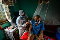 A man is vaccinated in a remote area of Moju, Para state, Brazil
