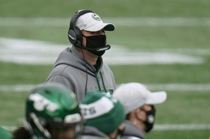 New York Jets head coach Adam Gase watches from the sideline in the first half of an NFL football game against the New England Patriots, Sunday, Jan. 3, 2021, in Foxborough, Mass. (AP Photo/Charles Krupa)