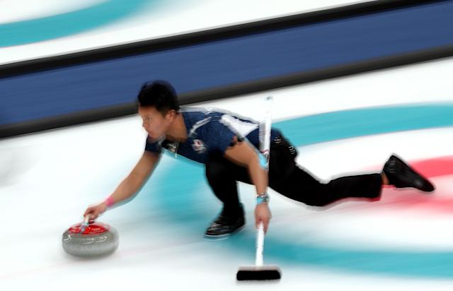 Japan's curling team had, at least on the surface, one of the most embarrassing throws of the Olympics. (Getty)