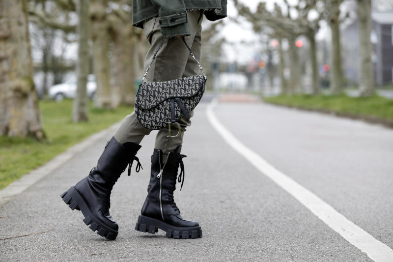 DUSSELDORF, GERMANY - MARCH 20: Black monolith boots by Prada and a Dior saddle bag as a detail of influencer Gitta Banko during a street style shooting on March 20, 2020 in Dusseldorf, Germany. (Photo by Isa Foltin/Getty Images)