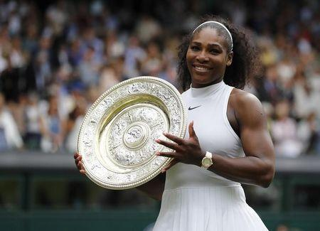 Britain Tennis - Wimbledon - All England Lawn Tennis & Croquet Club, Wimbledon, England - 9/7/16 USA's Serena Williams celebrates winning her womens singles final match against Germany's Angelique Kerber with the trophy REUTERS/Stefan Wermuth