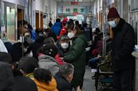 Families of coronavirus victims in Wuhan accuse the local government of concealing the outbreak when it first emerged in the city late last year
