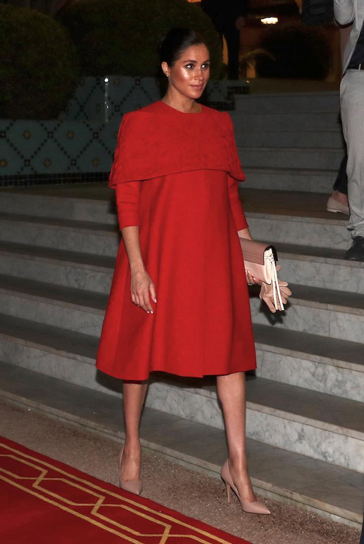 The Duchess of Sussex kick-started her final overseas tour before giving birth in a caped Valentino gown – a sartorial tribute to the Moroccan flag. [Photo: Getty]