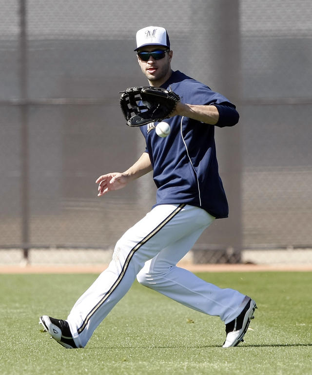 Milwaukee Brewers left fielder Ryan Braun (8) warms up during a spring training baseball practice, Sunday, Feb. 22, 2014, in Phoenix, Ariz. (AP Photo/Rick Scuteri)