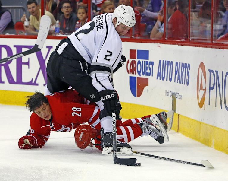 Carolina Hurricanes' Alexander Semin (28) of Russia, collides with Los Angeles Kings' Matt Greene (2) during the second period of an NHL hockey game, Friday, Oct. 11, 2013, in Raleigh, N.C. (AP Photo/Karl B DeBlaker)