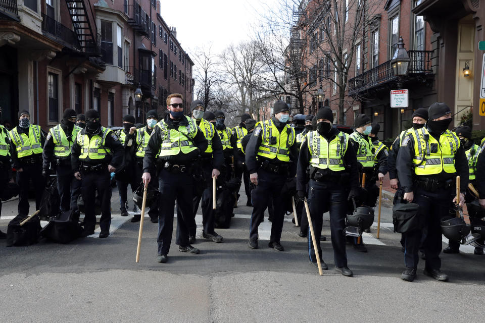 FILE - In this Jan. 17, 2021, file photo, Boston police officers stand in a street in the Beacon Hill neighborhood near the Statehouse in Boston as a precaution against demonstrations following the breach of the U.S. Capitol earlier in the month. Boston's police department remains largely white, despite vows for years by city leaders to work toward making the police force look more like the community it serves. (AP Photo/Michael Dwyer, File)