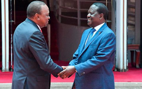 Kenya's President Uhuru Kenyatta (L) and National Super Alliance (NASA) coalition opposition leader Raila Odinga shake hands after addressing a press conference on March 9, 2018  - Credit:  AFP